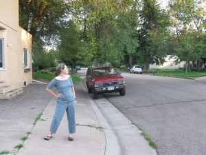 Dee Amick in front of the old Charvat's Grocery, part of the proposed landmark district.